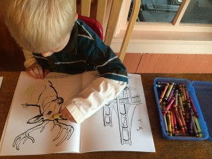 child coloring a Michigan coloring book