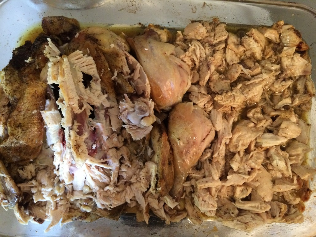 roasted chicken breast meat cut up and soaking in juices legs cut off