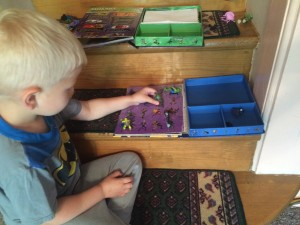 Elliot Playing with His Mini Figures