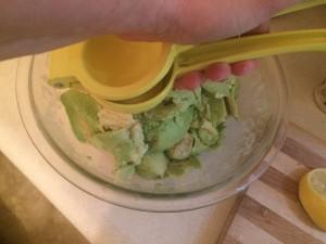 Squeezing Lemon on Avocado