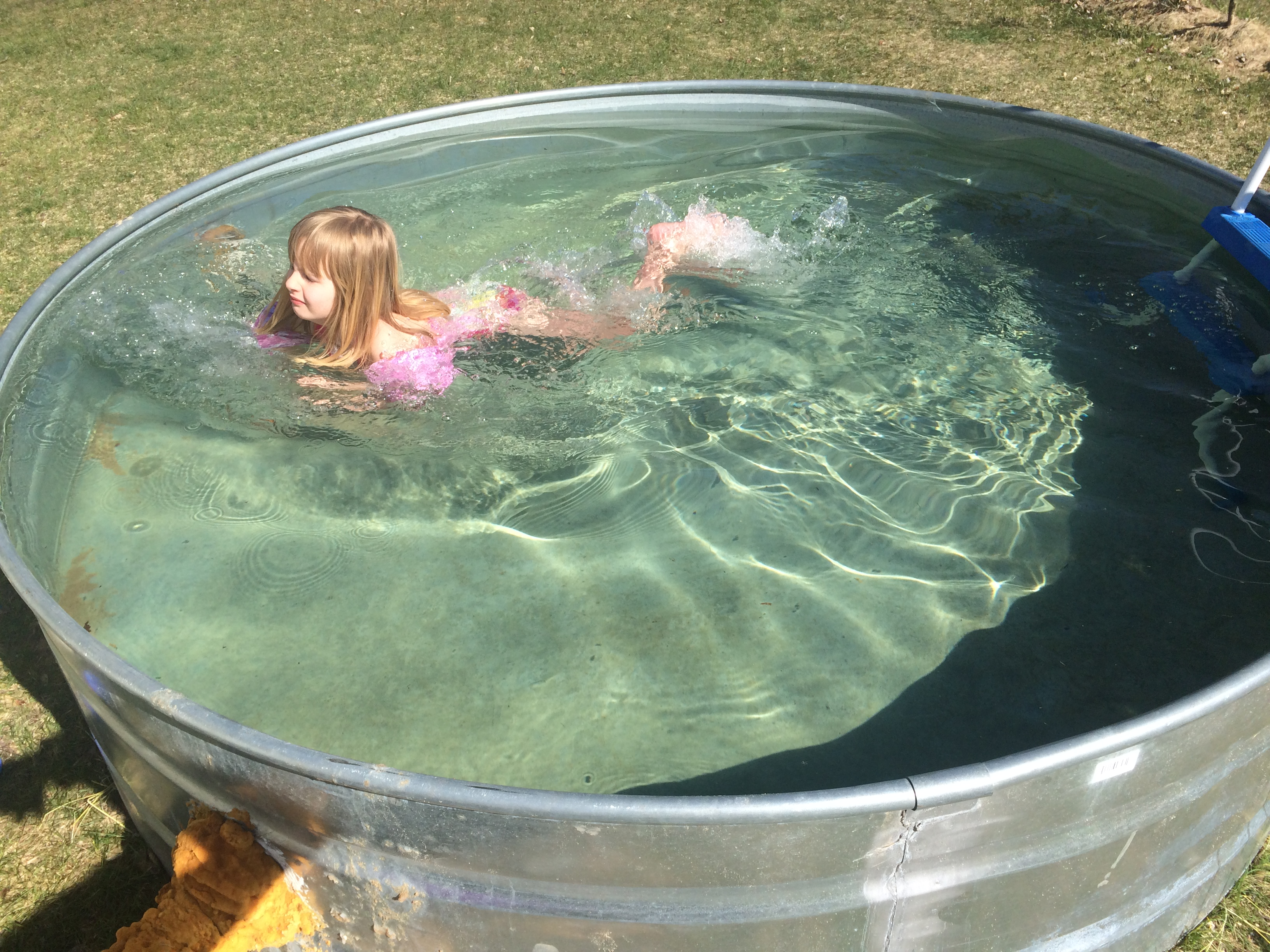 How to make a stock tank pool embracing motherhood for Koi pond kiddie pool