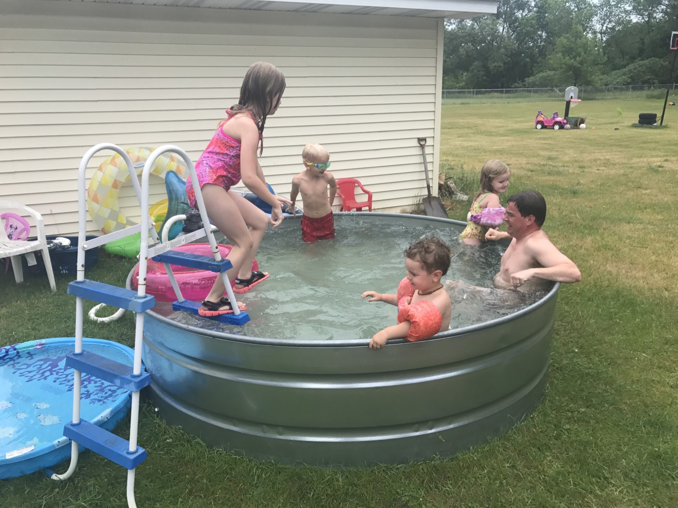 How to Make a Stock Tank Pool | Embracing Motherhood