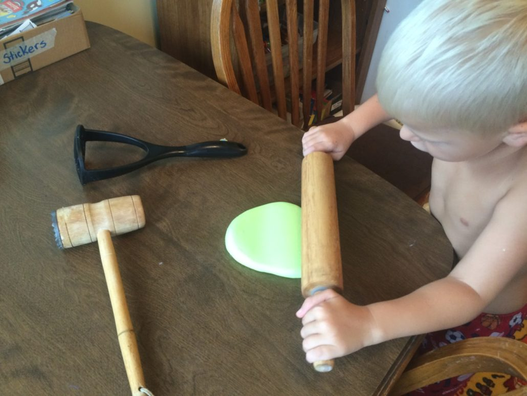 Elliot Rolling Out Slime Putty with a Rolling Pin
